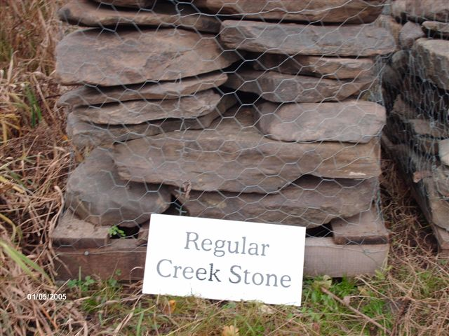 We deliver pallets of irregular creek stones.