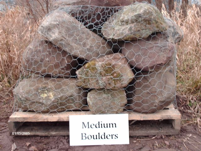 We deliver pallets of these medium boulbers.